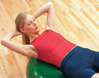 Woman training on a stability ball